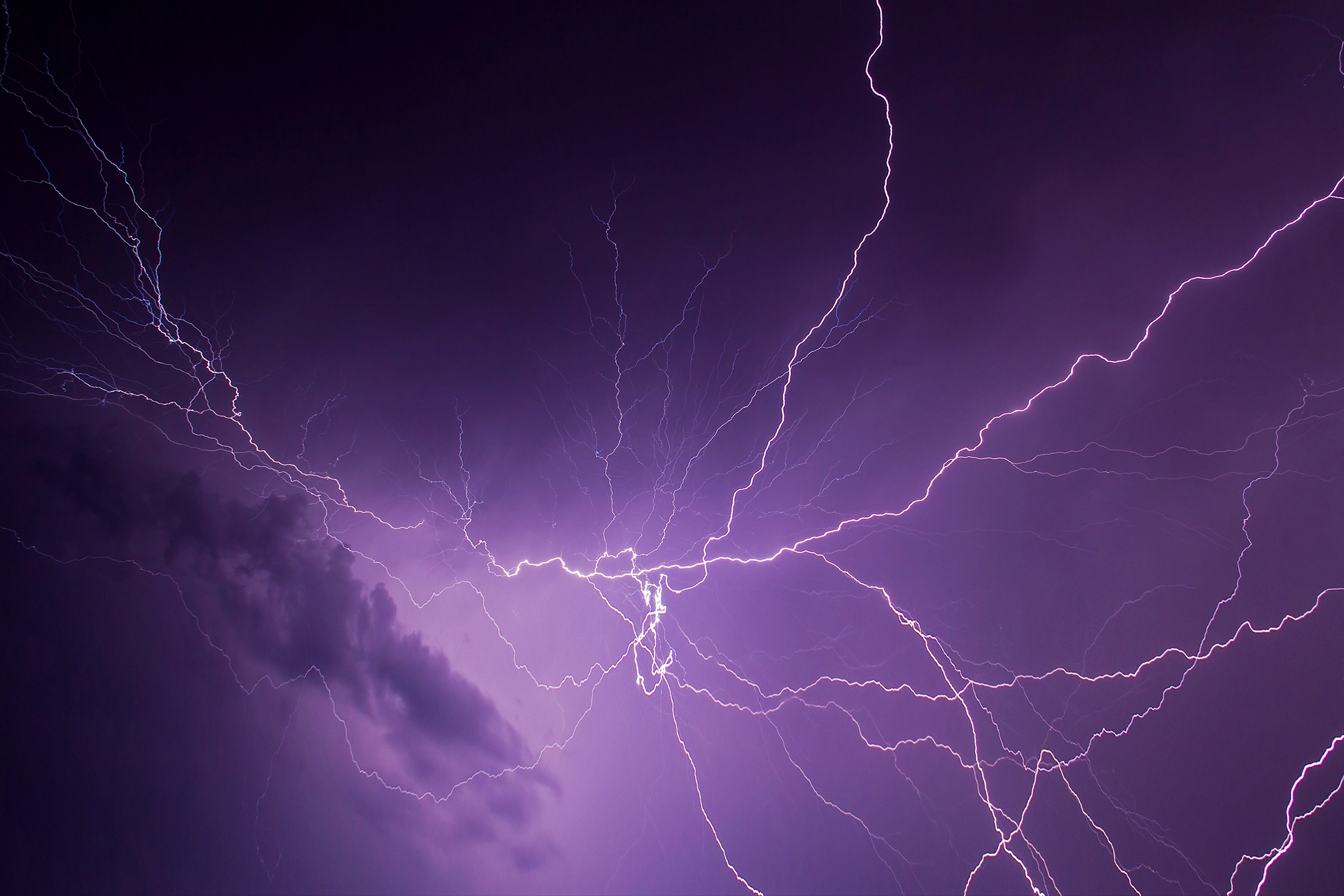 Lightning across a purple sky